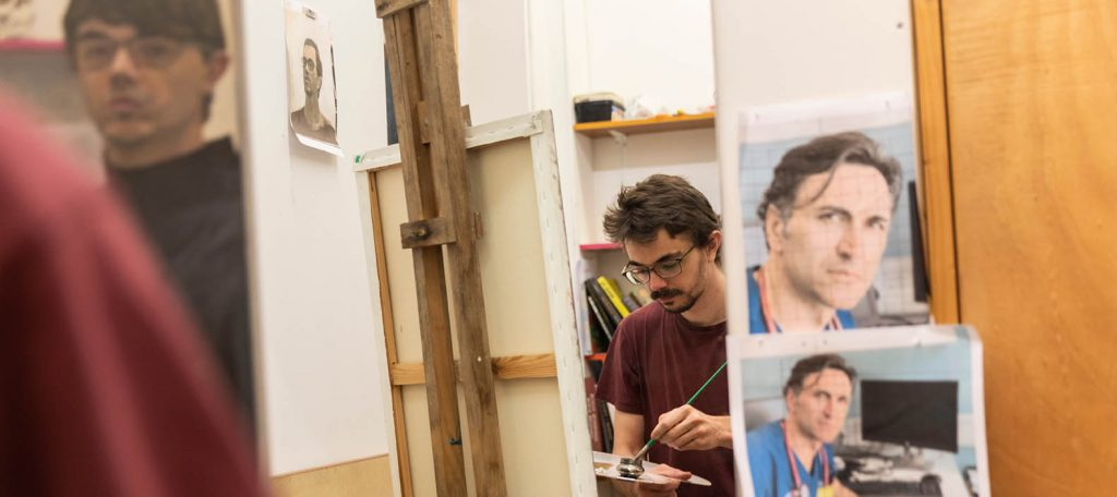 Jonathan Farningham painting a portrait in his studio